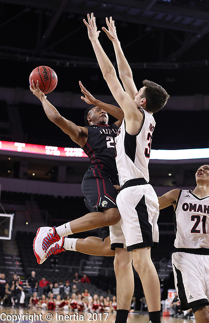SIOUX FALLS, SD: MARCH 6:  Ron Patterson #25 of IUPUI drives on Zach Pirog #33 of Omaha during the Summit League Basketball Championship on March 6, 2017 at the Denny Sanford Premier Center in Sioux Falls, SD. (Photo by Dick Carlson/Inertia)