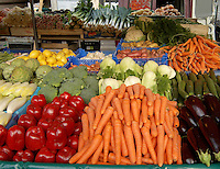 Vegetables on market stall at the open, fish,cheese and vegetable market at Bastile, Paris