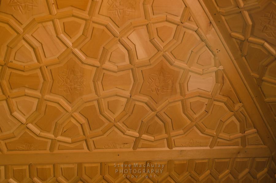 Interior detail views of carved ceiling design in master bedroom of traditional Kashmiri houseboat, Dal Lake, Srinagar, Kashmir, India.