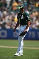 OAKLAND, CA - AUGUST 15:  Jeurys Familia #32 of the Oakland Athletics reacts while pitching against the Seattle Mariners during the game at the Oakland Coliseum on Wednesday, August 15, 2018 in Oakland, California. (Photo by Brad Mangin)
