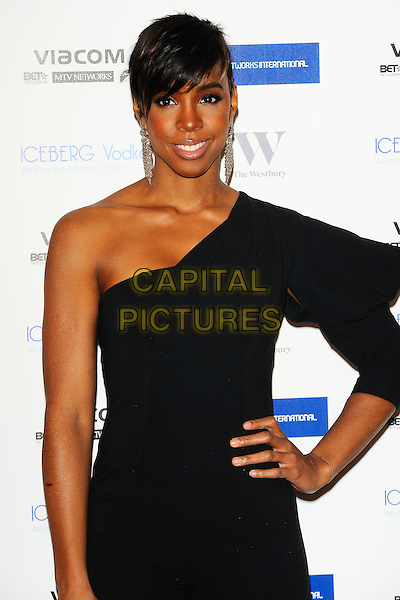 KELLY ROWLAND .MTV Staying Alive Foundation Dinner at the Westbury Hotel , London, England, UK, 27th January 2011..half length one sleeve shoulder hand on hip jumpsuit catsuit black.CAP/CJ.©Chris Joseph/Capital Pictures.
