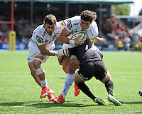David Ewers of Exeter Chiefs drives into Marcelo Bosch of Saracens as Luke Cowan-Dickie of Exeter Chiefs supports