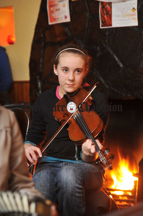 Laura Donnellan, a member of the Tulla Junior Ceili Band, performing in a session as part of the 200th anniversary celebrations at Peppers of Feakle. Photograph by John Kelly.