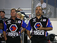 Apr. 5, 2013; Las Vegas, NV, USA: NHRA crew chiefs Mark Oswald (left) and Brian Corradi for top fuel dragster driver Antron Brown during qualifying for the Summitracing.com Nationals at the Strip at Las Vegas Motor Speedway. Mandatory Credit: Mark J. Rebilas-