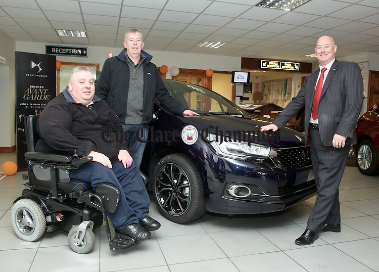 Noel Gavin and Finbar Ryan of O Sullivan And Hansbury welcome Chris Graham, MD Citroen And DS Ireland, to Ennis with the new DS4. Photograph by John Kelly