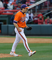 Reliever Matt Campbell (36) of the Clemson Tigers yells as he celebrates the final strikeout in a 6-3 win over the South Carolina Gamecocks on Saturday, March 2, 2013, at Fluor Field at the West End in Greenville, South Carolina. (Tom Priddy/Four Seam Images)