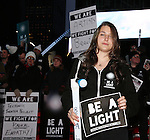Leah Lane attends The Ghostlight Project to light a light and make a pledge to stand for and protect the values of inclusion, participation, and compassion for everyone - regardless of race, class, religion, country of origin, immigration status, (dis)ability, gender identity, or sexual orientation at The TKTS Stairs on January 19, 2017 in New York City.