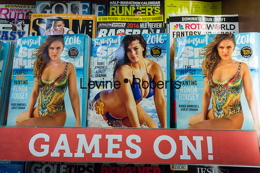 The Sports Illustrated 2016 swimsuit issue of the magazine is seen with other tabloid magazines displayed in a newsstand in New York on Wednesday, February 16, 2016. This year the magazine boasts three separate covers featuring Ashley Graham, Rhonda Rousey and Hailey Clauson in their bikinis (and in Rousey's case, body paint). The accompanying app for the issue also contains VR clips that can watched on smartphones or dedicated virtual reality gear. (© Richard B. Levine)
