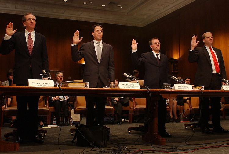 "Patterson4/121102 -- From left, Michael Patterson, Andrew Feldstein, Eric Peiffer, and Robert Traband, all of J.P. Morgan Chase & Co., get sworn in at the Enron Permanent Investigations Subcommittee hearing, ""Oversight of Investment Bank's Response to the lessons of Enron.""  The hearing took testimony from major financial institutions to see whether they were involved in the collapse of Enron."