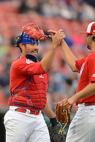 Buffalo Bisons catcher Mike Nickeas #11 and pitcher John Stilson #41 celebrate after the first game of a double header against the Lehigh Valley IronPigs on June 7, 2013 at Coca-Cola Field in Buffalo, New York.  Buffalo defeated Lehigh Valley 4-3.  (Mike Janes/Four Seam Images)