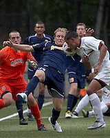 Quinnipiac University defender Matthew Rothbart (14) corner kick defense. Boston College defeated Quinnipiac, 5-0, at Newton Soccer Field, September 1, 2011.