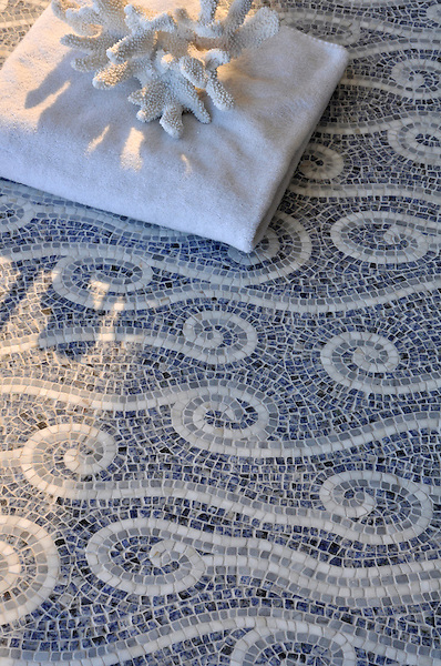 Eddies, a hand-chopped stone mosiac shown in Blue Bahia, Bardiglio, and Carrara, is part of the Silk Road collection by Sara Baldwin for New Ravenna.