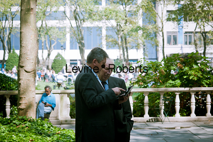 Park visitors use a tablet computer in Bryant Park in New York on Thursday, September 27, 2012 (© Richard B. Levine)