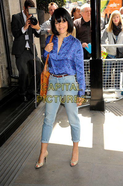 Natasha Khan (Bat For Lashes).58th annual Ivor Novello songwriting and composing awards, Grosvenor House, London, England, UK, 16th May 2013..full length jeans cropped tucked in belt blue fringe shirt print tan bag brown.CAP/CJ.©Chris Joseph/Capital Pictures.