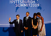 Pittsburgh, PA - September 24, 2009 -- United States President Barack Obama (2nd L) welcomes French President Nicolas Sarkozy (L) to the welcoming dinner for G-20 leaders at the Phipps Conservatory on Thursday, September 24, 2009 in Pittsburgh, Pennsylvania as U.S. first lady Michelle Obama (R) and Carla Sarkozy (2nd R) talk with each other. Heads of state from the world's leading economic powers arrived today for the two-day G-20 summit held at the David L. Lawrence Convention Center aimed at promoting economic growth. .Credit: Win McNamee / Pool via CNP