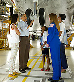 United States President Barack Obama, First Lady Michelle Obama, daughters Malia, left, Sasha, and Astronaut Janet Kavandi walk under the landing gear from beneath the nose of space shuttle Atlantis as they visit Kennedy Space Center in Cape Canaveral, Florida, Friday, April 29, 2011..Mandatory Credit: Bill Ingalls / NASA via CNP