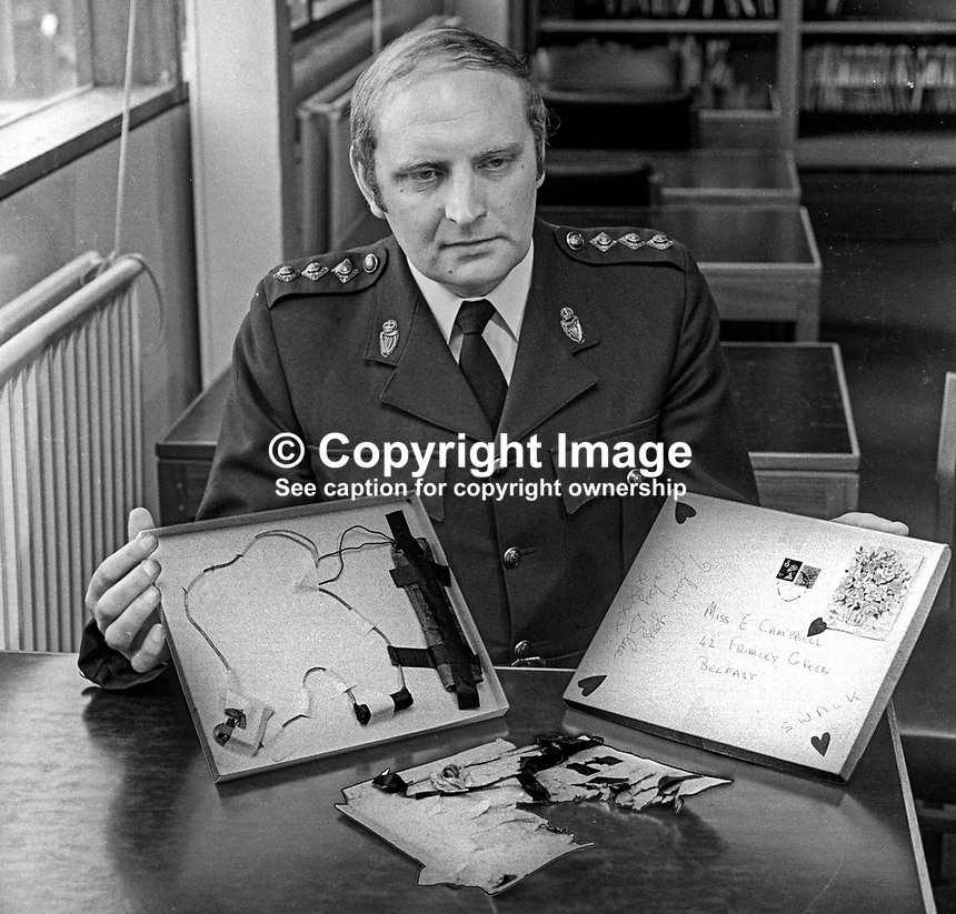 Chief Inspector Hugh McMorris, Andersonstown Police Station, Belfast, N Ireland, displays a Valentine Card letter bomb which exploded injuring a woman and her 6 year old daughter at their home in Whiterock Gardens. At the Press Conference at the N Ireland Forensic Science department he also displays a Valentine Card letter bomb which had been successfully defused. 13th February 1975. 197502130135<br /> <br /> Copyright Image from Victor Patterson, 54 Dorchester Park, Belfast, UK, BT9 6RJ<br /> <br /> Tel: +44 28 9066 1296<br /> Mob: +44 7802 353836<br /> Voicemail +44 20 8816 7153<br /> Skype: victorpattersonbelfast<br /> Email: victor@victorpatterson.com<br /> Email: victorpatterson@me.com (back-up)<br /> <br /> IMPORTANT: If you wish to use this image or any other of my images please go to www.victorpatterson.com and click on the Terms &amp; Conditions. Then contact me by email or phone with the reference number(s) of the image(s) concerned.
