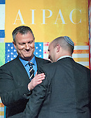 Erel Margalit, Member of Knesset, and the Labor Party's candidate for Israel Minister of Economy, left, meets Naftali Bennett, current Israel Economy Minister, right, prior to Margalit's speaking at a luncheon during the AIPAC Policy Conference in Washington, D.C. on Sunday, March 1, 2015.<br /> Credit: Ron Sachs