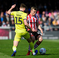 Lincoln City's Harry Anderson vies for possession with Cheltenham Town's William Boyle<br /> <br /> Photographer Chris Vaughan/CameraSport<br /> <br /> The EFL Sky Bet League Two - Lincoln City v Cheltenham Town - Saturday 13th April 2019 - Sincil Bank - Lincoln<br /> <br /> World Copyright &copy; 2019 CameraSport. All rights reserved. 43 Linden Ave. Countesthorpe. Leicester. England. LE8 5PG - Tel: +44 (0) 116 277 4147 - admin@camerasport.com - www.camerasport.com