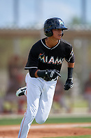 GCL Marlins left fielder Jorge Caballero (15) runs to first base during a game against the GCL Cardinals on August 4, 2018 at Roger Dean Chevrolet Stadium in Jupiter, Florida.  GCL Marlins defeated GCL Cardinals 6-3.  (Mike Janes/Four Seam Images)