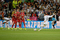 Cardiff City Stadium, Cardiff, South Wales - Tuesday 12th Aug 2014 - UEFA Super Cup Final - Real Madrid v Sevilla - <br /> <br /> Real Madrid&rsquo;s Gareth Bale takes a free kick during the game. <br /> <br /> <br /> <br /> <br /> Photo by Jeff Thomas/Jeff Thomas Photography