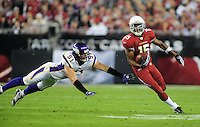 Dec 6, 2009; Glendale, AZ, USA; Minnesota Vikings linebacker (51) Ben Leber dives as he attempts to tackle Arizona Cardinals wide receiver (15) Steve Breaston in the first quarter at University of Phoenix Stadium. Mandatory Credit: Mark J. Rebilas-