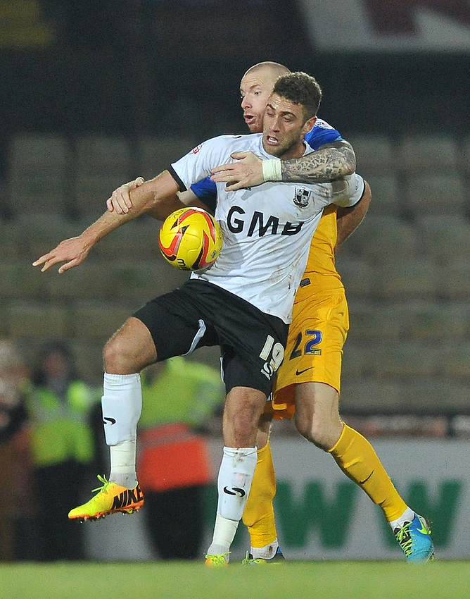 Preston North End's Jack King and Port Vale's Ben Williamson battle for the ball<br /> <br /> Photo by Dave Howarth/CameraSport<br /> <br /> Football - The Football League Sky Bet League One - Port Vale v Preston North End - Tuesday 26th November 2013 - Vale Park - Burslem<br /> <br /> &copy; CameraSport - 43 Linden Ave. Countesthorpe. Leicester. England. LE8 5PG - Tel: +44 (0) 116 277 4147 - admin@camerasport.com - www.camerasport.com