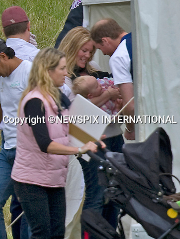 """PRINCE WILLIAM PLAYS WITH COUSIN SAVANNAH.KATE HAS FAMILY DAY WITH PRINCES WILLIAM AND HARRY AT POLO.Catherine, Duchess of Cambridge joined Princes William and Harry extended family at the Polo..They included Zara Phillips and husband Mike Tindall, Peter Phillips, Autumn and children Savannah and Isla..Kate and William also brought along their new puppy Lupo to the event..The Princes were playing in a charity polo match at Beaufort, Gloucestershire_17/06/2012.Mandatory Credit Photo: ©NEWSPIX INTERNATIONAL..**ALL FEES PAYABLE TO: """"NEWSPIX INTERNATIONAL""""**..IMMEDIATE CONFIRMATION OF USAGE REQUIRED:.Newspix International, 31 Chinnery Hill, Bishop's Stortford, ENGLAND CM23 3PS.Tel:+441279 324672  ; Fax: +441279656877.Mobile:  07775681153.e-mail: info@newspixinternational.co.uk"""