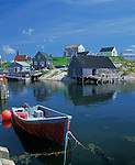 Halifax County, Nova Scota<br /> Morning sun on a red skiff and the village homes and boat houses of Peggy's Cove