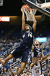 Utah State's Jalen Moore (14) scores against Nevada during an NCAA college basketball game in Reno, Nev., on Tuesday, Jan. 20, 2015. Utah State's David Collette (13) and Nevada's Eric Cooper (21) are at rear. (AP Photo/Cathleen Allison)