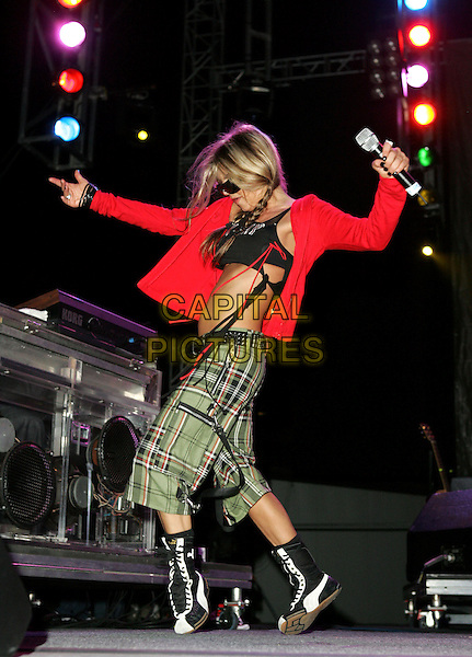 STACIE 'FERGIE' FERGUSON.The Black Eyed Peas perform to a massive crowd at The 20th Anniversary of The San Diego Street Scene held at Petco Park in Downtown San Diego, California .August 27, 2004.full length, stage, concert, gig, live, music, dancing, red cardigan, sweater, burberry, shorts, trousers, belly, stomach, midriff, shoes.www.capitalpictures.com.sales@capitalpictures.com.©Debbie VanStory