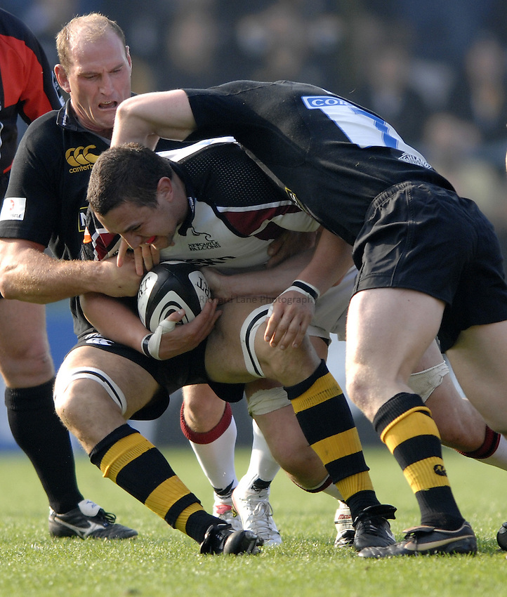 Photo: Richard Lane..London Wasps v Newcastle Falcons. Guinness Premiership. 15/10/2006. .Falcons' Phil Dowson is tackled by Lawrence Dallaglio.