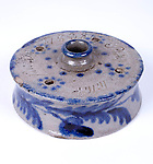 1955.20.1<br /> Inkwell<br /> 1793, Baltimore<br /> Glazed redware by Peter Perine, Jr.<br /> Gift of MIss Agnes Perine and Mrs. Edith Perine Reinhardt<br /> Museum Department<br /> This inkwell represents the earliest signed example of pottery made in the city.<br /> Philip Muller, 7/4/1838