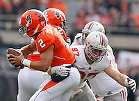Illinois Fighting Illini quarterback Nathan Scheelhaase (2) is tackled by Ohio State Buckeyes defensive lineman Joey Bosa (97) during Saturday's NCAA Division I football game at Memorial Stadium in Champaign, Il., on November 16, 2013. Ohio State won the game 60-35. (Barbara J. Perenic/The Columbus Dispatch)