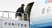 Chicago, IL - December 20, 2008 -- United States President-elect  Barack Obama boards a plane for a 12-day vacation in Hawaii at Chicago's O'Hare International airport Saturday December 20, 2008, in Chicago, Illinois. .Credit: Frank Polich - Pool via CNP