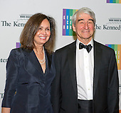 Sam Waterston and his wife, Lynn, arrive for the formal Artist's Dinner honoring the recipients of the 2013 Kennedy Center Honors hosted by United States Secretary of State John F. Kerry at the U.S. Department of State in Washington, D.C. on Saturday, December 7, 2013. The 2013 honorees are: opera singer Martina Arroyo; pianist,  keyboardist, bandleader and composer Herbie Hancock; pianist, singer and songwriter Billy Joel; actress Shirley MacLaine; and musician and songwriter Carlos Santana.<br /> Credit: Ron Sachs / CNP