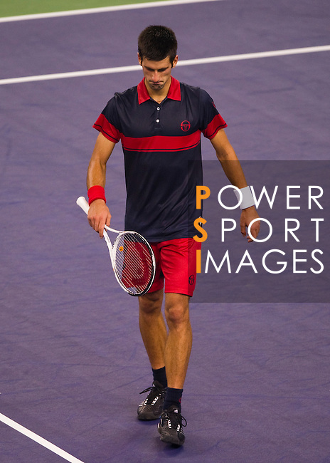 SHANGHAI, CHINA - OCTOBER 16:  Novak Djokovic of Serbia reacts after loosing a point against Roger Federer of Switzerland during day six of the 2010 Shanghai Rolex Masters at the Shanghai Qi Zhong Tennis Center on October 16, 2010 in Shanghai, China.  (Photo by Victor Fraile/The Power of Sport Images) *** Local Caption *** Novak Djokovic