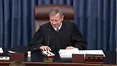 In this image from United States Senate television, Chief Justice of the US John G. Roberts, Jr. grants the motion to adjourn during the President's impeachment trial of US President Donald J. Trump in the US Senate in the US Capitol in Washington, DC on Saturday, January 25, 2020.  The Senate stands in adjournment until Monday, January 27, 2020.<br /> Mandatory Credit: US Senate Television via CNP