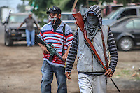 Movement of Auto defenses in Michoacan Mexico. Armed community, armed civilian poodles, population at war against gunmen, drug cartels and Mexican mafia. Goat horns and long weapons. Innocent population is armed to fight against organized crime (Photo: JoseEstradaSerafin / NortePhoto.com)<br />