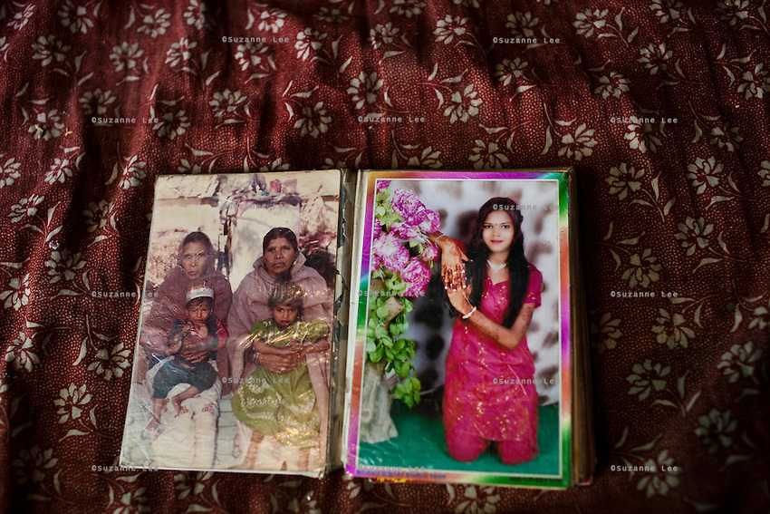 Sadma Khan, now 19, displays a photo (right) which was used to find her a husband: Waseem Khan, now 26, as she sits in her mother's house in Tonk, Rajasthan, India, on 19th June 2012. She was married at 17 years old to Waseem Khan. The couple have an 18 month old baby and Sadma is now 3 months pregnant with her 2nd child and plans to use contraceptives after this pregnancy. She lives with her mother since Waseem works in another district and she can't take care of her children on her own. Photo by Suzanne Lee for Save The Children UK