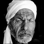 Ismail Ibrahim Abu Eida and I sat together near the rubble of what had once been his family home, sipping our freshly brewed cups of tea He seemed to take pleasure in poking at the wood fire under the tea pot, and refilling the cups of those sitting about him. <br /> <br /> He sat in the dirt, while I balanced myself on a 3-and-a-half legged plastic chair that had been bought over for me. The mist that covered the citrus groves was now lifting as the day grew hotter, revealing the devastation that had once been the Jabaliya industrial zone. <br /> <br /> He pointed towards the West and said &quot;There is Israel.&quot; I could see a wire fence, and the silhouettes of soldiers walking along it. Israeli farmers had begun working their fields that morning as jeeps filled with soldiers raced back and forth along the border areas and snipers kept an eye on the few Palestinians who dared to return to their lands.  Despite the cease fire, farmers were being shot and killed at random.  <br /> <br /> &quot;I used to work in Israel,&quot; he mumbled after a few minutes &quot;but that was a different time, a different world.&quot;