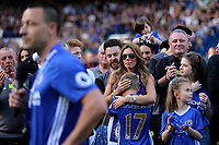 Toni Terry, wife of John Terry, cuddles their son Georgie, as she listens to her husband's farewell speech during Chelsea vs Sunderland AFC, Premier League Football at Stamford Bridge on 21st May 2017