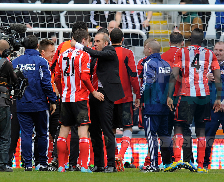 Sunderland manager Paolo Di Canio (C) congratulates Adam Johnson of Sunderland at the end of the game - Barclays Premier League - Newcastle Utd vs Sunderland - St. James' Park - Newcastle - 14/04/13 - Picture Richard Lee/Sportimage