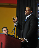 Ashburn, VA - March 3, 2009 -- Newly re-signed Washington Redskins guard Derrick Dockery makes remarks at a press conference at Redskins Park in Ashburn, Virginia on Tuesday, March 3, 2009.  Dockery signed a 5 year, $27 million contract that features a $8.5 million guarantee and calls for $11.5 million to be paid over the first 2 years.  Head coach Jim Zorn looks on from left..Credit: Ron Sachs / CNP