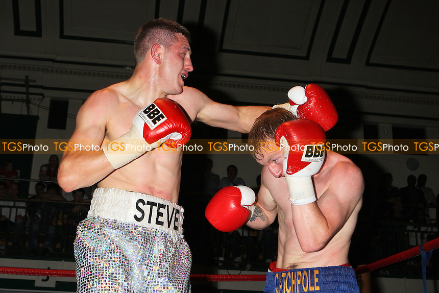 Joe Catchpole (blue/gold shorts) defeats Steve Spence (silver shorts) in a Light-Middleweight boxing contest at York Hall, Bethnal Green, promoted by Spencer Fearon/HardKnocks - 18/06/11 - MANDATORY CREDIT: Gavin Ellis/TGSPHOTO - Self billing applies where appropriate - Tel: 0845 094 6026