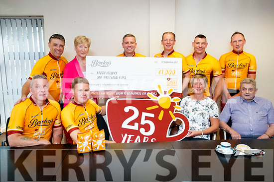 Pictured presenting a cheque of €1,000 to the Palliative Care Unit at University Hospital Kerry, from a recent fundraiser Cycle from University Hospital Kerry to Dublin, on Friday morning last, were front l-r: Charlie Scully, Gary Clarke, Maura Sullivan and Ted Moynihan. Back l-r: Jason Doyle, Mairead Fernane, Mark Saunders, Eamon Diver, Yohann Davis and Dylan Rafter.