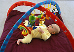 Berkeley CA Girl three-months-old fascinated by baby gym toys, starting to reach  MR