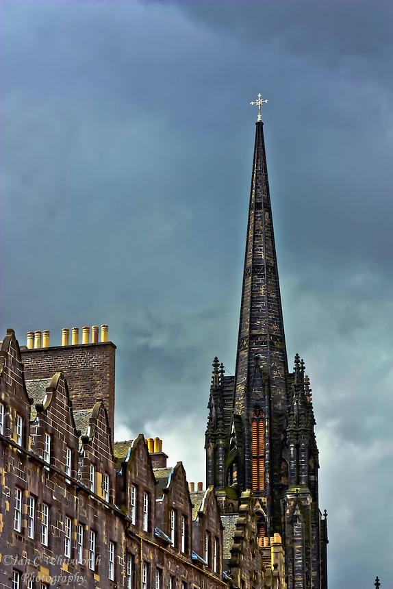 A view below the Edinburgh Castle of a church steeple