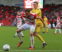 Doncaster Rovers' Joe Wright shields the ball from Fleetwood Town's Ashley Hunter<br /> <br /> Photographer David Shipman/CameraSport<br /> <br /> The EFL Sky Bet League One - Doncaster Rovers v Fleetwood Town - Saturday 6th October 2018 - Keepmoat Stadium - Doncaster<br /> <br /> World Copyright © 2018 CameraSport. All rights reserved. 43 Linden Ave. Countesthorpe. Leicester. England. LE8 5PG - Tel: +44 (0) 116 277 4147 - admin@camerasport.com - www.camerasport.com