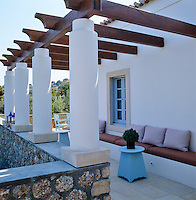 The villa is surrounded by a series of terraces each furnished with a different seating arrangement